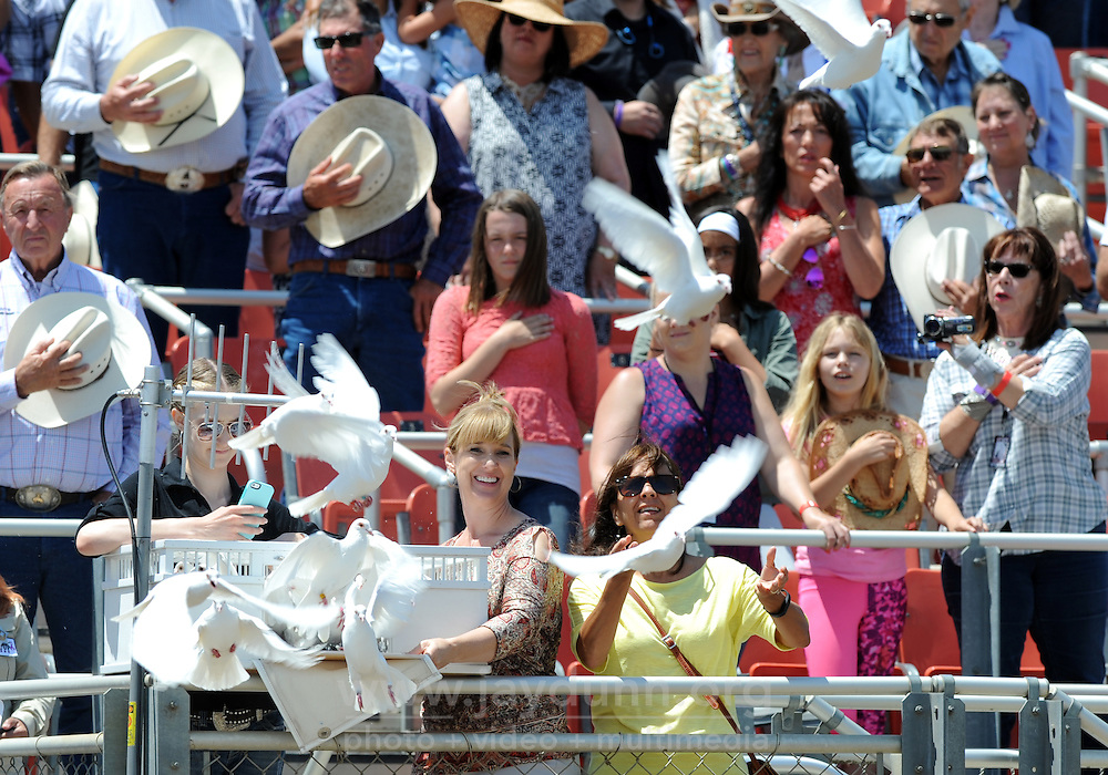 White doves are released during the national anthem on Sunday, the Day of Champions and Man Up Crusade Day at the 2016 California Rodeo Salinas.