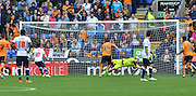 Emiliano Mart?nez is unable to stop the spot kick of Zach Clough during the Sky Bet Championship match between Bolton Wanderers and Wolverhampton Wanderers at the Macron Stadium, Bolton, England on 12 September 2015. Photo by Mark Pollitt.
