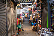 16 FEBRUARY 2013 - BANGKOK, THAILAND:  An aisle in Chatuchak Weekend Market in Bangkok. It is reportedly the largest market in Thailand and the world's largest weekend market. Frequently called J.J., it covers more than 35 acres and contains upwards of 5,000 stalls.        PHOTO BY JACK KURTZ