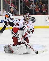 Feb 16; Newark, NJ, USA; Carolina Hurricanes goalie Cam Ward (30) makes a save during the second period at the Prudential Center.
