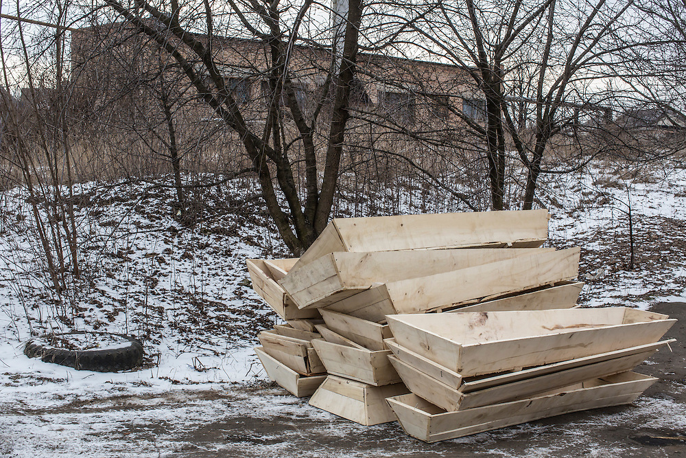 ARTEMIVSK, UKRAINE - FEBRUARY 19: Empty coffins are stacked outside the local morgue on February 19, 2015 in Artemivsk, Ukraine. Ukrainian forces started withdrawing from the strategic and hard-fought town of Debaltseve yesterday being effectively surrounded by pro-Russian rebels, and many are feared dead. (Photo by Brendan Hoffman/Getty Images) *** Local Caption ***