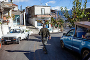 A man walking the main road in Maza, a mountain village located close to Palaiochora which is a small town in Chania regional unit on the island of Crete, Greece. In the back the White Mountains (Lefka Ori).