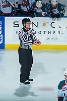 KELOWNA, CANADA - MARCH 14: Linesman Dustin Minty catches the puck on the ice at the Kelowna Rockets against the Prince George Cougars  on March 14, 2018 at Prospera Place in Kelowna, British Columbia, Canada.  (Photo by Marissa Baecker/Shoot the Breeze)  *** Local Caption ***
