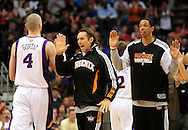 Feb. 23, 2011; Phoenix, AZ, USA; Phoenix Suns center Marcin Gortat (4) is congratulated by teammates guard Steve Nash (13) and forward Channing Frye (8) while playing the Atlanta Hawks at the US Airways Center. Mandatory Credit: Jennifer Stewart-US PRESSWIRE..