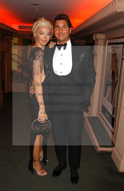 MISS TAMARA BECKWITH and MR GEORGE VERONI  at a party to celebrate 'Made in Italy at Harrods' - a celebration of Italian fashion food and wine, design and interiors, art and photography, cinema and music, beauty and glamour.  The party was held in the Georgian Restaurant at Harrods, Knightsbridge, London on 9th September 2004.<br />