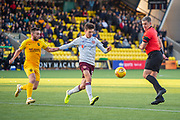 Aaron Hickey (#51) of Heart of Midlothian FC gets to the ball ahead of Steven Lawless (#11) of Livingston FC as referee Kevin Clancy watches on during the Ladbrokes Scottish Premiership match between Livingston FC and Heart of Midlothian at the Tony Macaroni Arena, Livingston, Scotland on 26 October 2019.