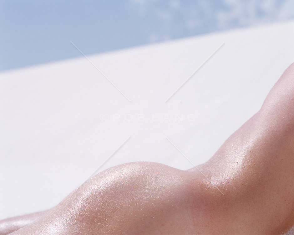 Detail of a nude man in the sand in White Sands, NM