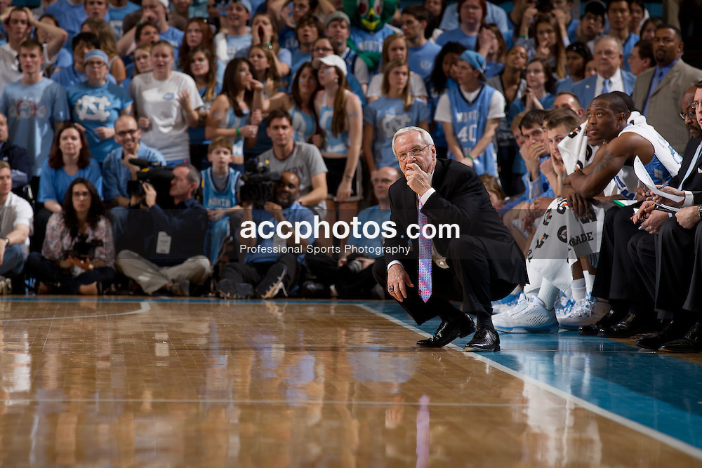 CHAPEL HILL, NC - FEBRUARY 19: Head coach Roy Williams of the North Carolina Tar Heels crouches down and watches his team play the Boston College Eagles on February 19, 2011 at the Dean E. Smith Center in Chapel Hill, North Carolina. North Carolina won 46-48.  (Photo by Peyton Williams/UNC/Getty Images) *** Local Caption *** Roy Williams