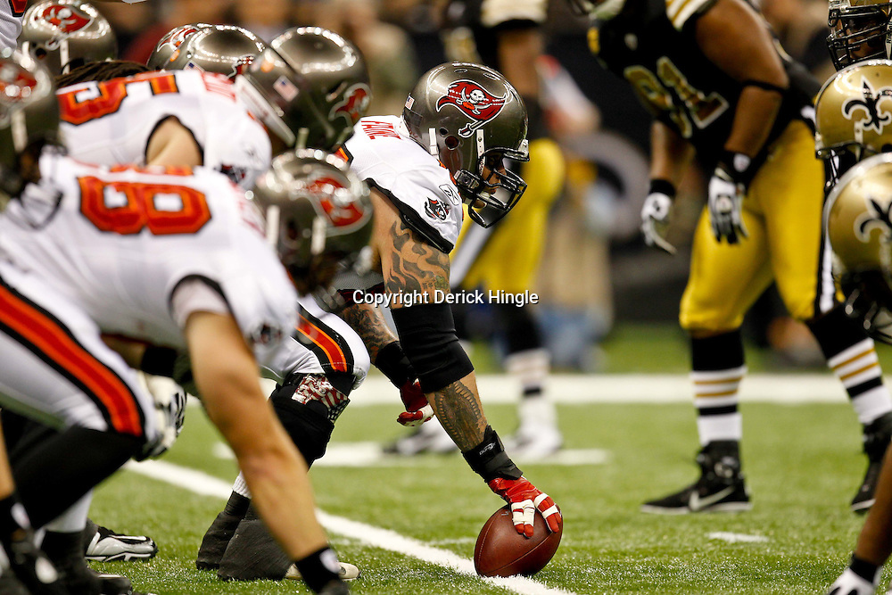 November 6, 2011; New Orleans, LA, USA; Tampa Bay Buccaneers center Jeff Faine (52) lines up against the New Orleans Saints during the first quarter of a game at the Mercedes-Benz Superdome. Mandatory Credit: Derick E. Hingle-US PRESSWIRE
