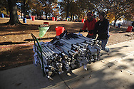 Zach Dudas (left) and Josh Blackmon prepare to set up tents for tailgating, in the Grove at Ole Miss, in Oxford, Miss. on Friday, November 28, 2014. Ole Miss hosts Mississippi State in the annual Egg Bowl on Saturday at 2:30 p.m.