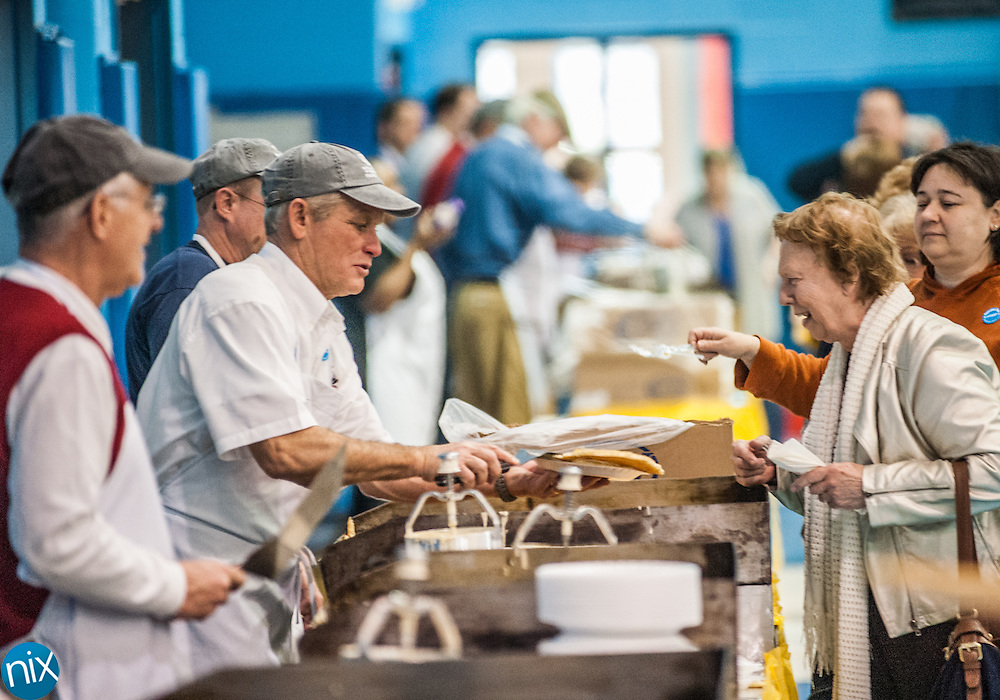 Jerry Bently hands out pancakes during the annual Boys & Girls Club Pancake Day fundraiser Thursday morning in Concord.