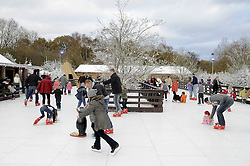© Licensed to London News Pictures. 26/11/2011. Lamberhurst ,UK. Parents and children ice skating on the opening day of LaplandUK  in Lamberhurst, Kent today (26/11/2011). The park which is recreated from scratch every year, recreates Father Christmas' arctic homeland. Photo credit : Grant Falvey/LNP