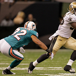 2009 September 03: New Orleans Saints running back Lynell Hamilton (30) evades a tackle attempt by Miami Dolphins safety Jason Allen (32) during a preseason game between the Miami Dolphins and the New Orleans Saints at the Louisiana Superdome in New Orleans, Louisiana.