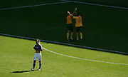 FIFA World Cup 2006 A dejected Naohiro Takahara of Japan at the end of the match as Lucas Neil and Tim Cahill of Australia celebrate victory