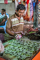 Local seller making betel nut at his stall in Mt Popa, Burma.
