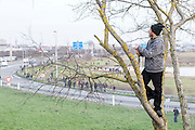 FRANCE, Calais: 17 December 2015 A refugee looks out over the horizon for riot police after clashing with them outside of the Euro Tunnel entrance in Calais this afternoon. Hundreds of refugees walked hours through Calais today to reach the Euro Tunnel from 'The Jungle' camp to try and get to England. Rick Findler  / Story