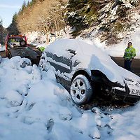 Perthshire Snow & Ice....06.01.10<br /> A VW Polo which crashed in the snow and ice is recovered from the A912 near Glenfarg on the outskirts of Perth.<br /> Picture by Graeme Hart.<br /> Copyright Perthshire Picture Agency<br /> Tel: 01738 623350  Mobile: 07990 594431