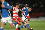 Ian Henderson is tackled during the The FA Cup 3rd round match between Doncaster Rovers and Rochdale at the Keepmoat Stadium, Doncaster, England on 6 January 2018. Photo by Daniel Youngs.