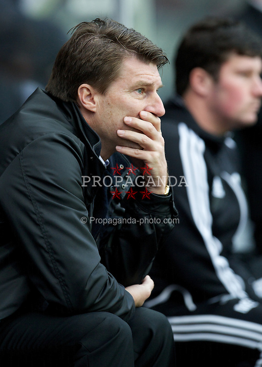 SWANSEA, WALES - Sunday, December 23, 2012: Swansea City's manager Brian Laudrup during the Premiership match against Manchester United at the Liberty Stadium. (Pic by David Rawcliffe/Propaganda)