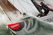 Emirates Team New Zealand NZL92 punches through a wave on approach to the top mark in the teams Round Robin two match of the Louis Vuitton cup against United Internet Team Germany GER89. 25/4/2007