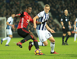 17 December 2016 - Premier League - West Bromwich Albion v Manchester United - Paul Pogba of Manchester United tries to turn Darren Fletcher of West Bromwich Albion in the box - Photo: Paul Roberts / Offside.