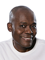 Close-up portrait of an attractive afro American man smiling in studio on white isolated background