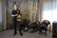 Nancy Harders poses for a portrait with the FFA Al Sick award at her home in Cairo. Harder was recently presented with the award which recognizes achievement and service to agriculture, agriculture education, Nebraska FFA and/or FFA Alumni. She is also enjoys hunting, fishing and other outdoor activities. (Independent/Matt Dixon)