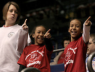"""(left to right) Michelle Bean, from Dayton, and daughters Jaelyn, 8 and Braelyn, 8 act out as """"YMCA"""" plays during a timeout in a UD Women's basketball game at the University of Dayton Arena, January 21, 2007."""