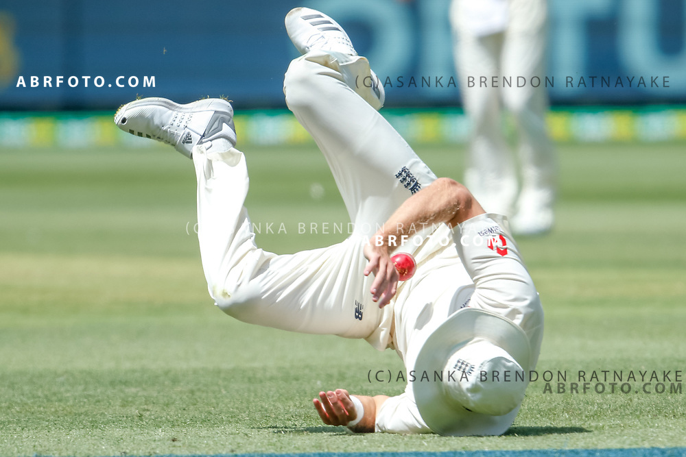Stuart Broad fields the ball as he falls over during day 4 of the 2017 boxing day test.