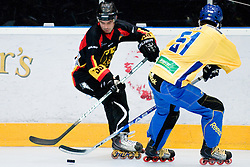 Thomas Greilinger of Germany vs. Rickard Wallin of Sweden at IIHF In-Line Hockey World Championships Quarter final match between national teams of Sweden and Germany on July 1, 2010, in Karlstad, Sweden. (Photo by Matic Klansek Velej / Sportida)