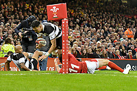 Rugby Union - 2019 / 2020 season - Wales vs. Barbarians<br /> <br /> Shaun Stevenson of the Barbarians   tackled by Josh Adams of Wales , at The Principality (Millennium) Stadium.<br /> <br /> COLORSPORT/WINSTON BYNORTH