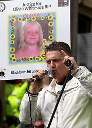 "© under license to London News Pictures. 02/04/2011: EDL leader Stephen Lennon (aka Tommy Robinson) addresses a rally in Blackburn. Prior to the rally, the EDL leader has stated that he's been warned off attending the rally by police, for his own safety. About 2000 EDL supporters were in attendance. It was one of the largest policing operations Lancashire police have ever put in to action. Credit should read ""Joel Goodman/London News Pictures""."