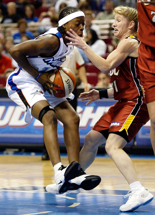Orlando Miracle's Shannon Johnson, left, collides with Miami Sol's Debbie Black, right, while driving to the basket during the first half Saturday, June 15, 2002, in Orlando, Fla. (AP Photo/Scott Audette)
