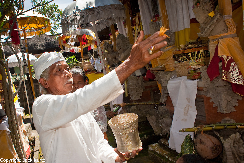 """Apr. 22 - UBUD, BALI, INDONESIA: Family members bless their temple during an Odalan ceremony in a family temple in Ubud, Bali, Indonesia. The Odalan ceremony is the """"birthday"""" ceremony for Hindu temples in Bali and are held every 210 days. They are common in Bali.   Photo by Jack Kurtz/ZUMA Press."""