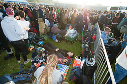 © Licensed to London News Pictures. 24/06/2015. Pilton, UK.   Festival goers arrive at Glastonbury Festival 2015 Wednesday Day 1 of the festival. It is just after dawn and people have been travelling thoughout the night.       The pedestrian gates to the festival opened at 8am this morning, with many festival goers arriving and waiting throughout last night for the opening.  This years headline acts include Kanye West, The Who and Florence and the Machine, the latter having been upgraded in the bill to replace original headline act Foo Fighters.  Photo credit: Richard Isaac/LNP