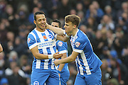 Brighton striker, Solomon March is congratulated by Brighton defender, full back, Liam Rosenior after scoring his goal during the Sky Bet Championship match between Brighton and Hove Albion and Milton Keynes Dons at the American Express Community Stadium, Brighton and Hove, England on 7 November 2015. Photo by Geoff Penn.