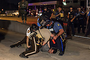 Police arrest a photographer during continued protests in Ferguson, Mo. on August 19th, 2014. (Samuel Corum/Legion Photo)