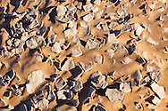 Dry earth and sand in the Sahara desert, Morocco.