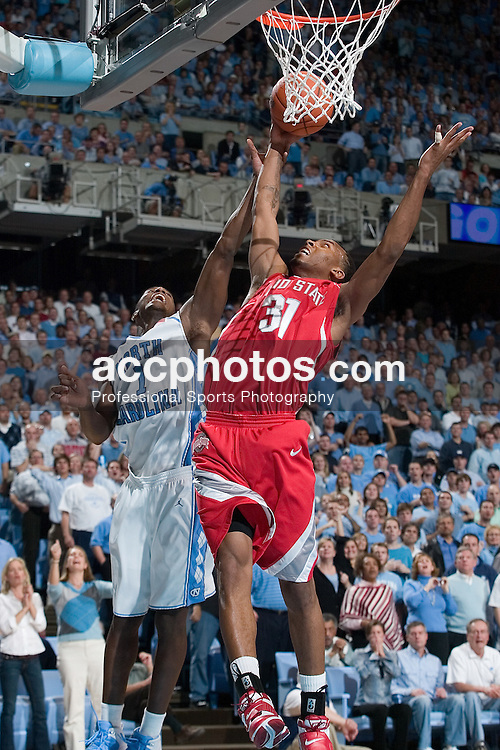 29 November 2006: Buckeye guard (31) Daequan Cook guarded by guard (1) Marcus Ginyard during a 98-89 North Carolina Tar Heels victory over the Ohio State Buckeyes, in the Dean Smith Center in Chapel Hill, NC.<br />