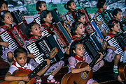 NORTH KOREA: Pyongyang.Young children perform synchronised singing and music at the Academy for Children
