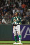 Oakland Athletics center fielder Rajai Davis (11) smiles after hitting a double against the San Francisco Giants at AT&T Park in San Francisco, California, on March 30, 2017. (Stan Olszewski/Special to S.F. Examiner)