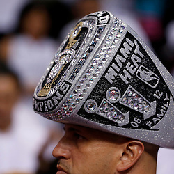 Jun 18, 2013; Miami, FL, USA; A Miami Heat fan wears a championship ring replica on his head prior to game six in the 2013 NBA Finals against the San Antonio Spurs at American Airlines Arena.  Mandatory Credit: Derick E. Hingle-USA TODAY Sports