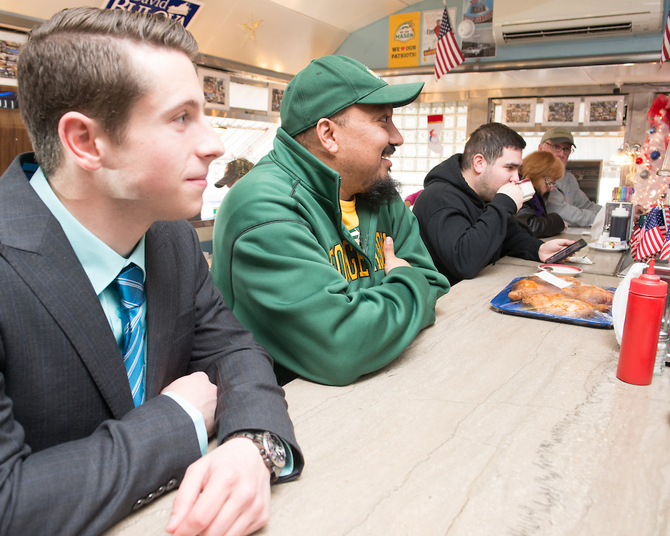December 5, 2015 - Fairfax, VA - A day in the life of &quot;Doc Nix,&quot; aka Dr. Michael Nickens, the Director of the Athletic Bands for George Mason University. At the Rte 29 Diner with former student Joe Antonucci.<br /> <br /> Photo by Susana Raab