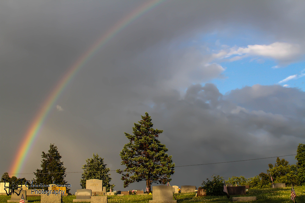 Rainbow in Ohio over a grave yard image for sale
