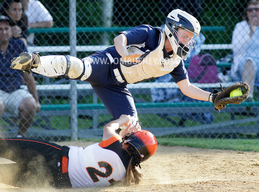Union-Endicott's Skyler Hoyt slides home safely as Pine Bush catcher Kelly Klewicki takes the late throw in the opening round of the state Class AA softball tournament at Minisink Valley's field in Slate Hill on Monday, June 3, 2013. Union-Endicott won the game 2-0.
