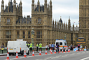© Licensed to London News Pictures. 18/07/2012. Westminster, UK A police security point on Westminster Bridge. Soldiers, police and security contractors perform security checks around Olympic sites in Westminster today, 18th July 2012. Photo credit : Stephen Simpson/LNP