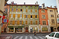 View of colorful, historic buildings found along the Thiou Canal, in Old Town Annecy, France.