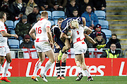 England's Jonny Lomax (1 St Helens) gets the tackle on Scotland's Lewis Tierney (2 Wigan Warriors during the Ladbrokes Four Nations match between England and Scotland at the Ricoh Arena, Coventry, England on 5 November 2016. Photo by Craig Galloway.