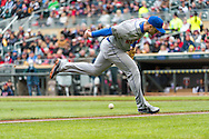 David Wright #5 of the New York Mets attempts to make a bare-handed grab on a bunt during a game against the Minnesota Twins on April 13, 2013 at Target Field in Minneapolis, Minnesota.  The Mets defeated the Twins 4 to 2.  Photo: Ben Krause