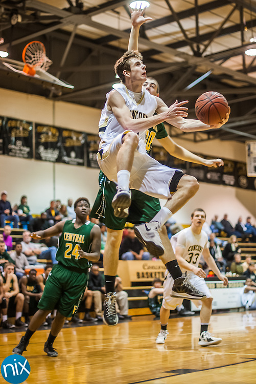 Concord's Connor Burchfield goes up for a shot against Central Cabarrus during the first round of the NCHSAA 3A playoff Monday night at Concord High School. Concord won the game 89-39.